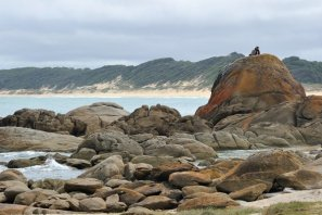 Rocks at Cape Conran with a young couple on top of the big rock.